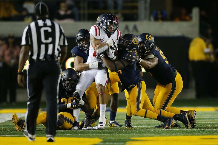 Mississippi Rebels running back Jordan Wilkins (22) is gang tackled during the first half of an NCAA football game between the California Golden Bears and the Mississippi Rebels at California Memorial Stadium on Saturday, Sept. 16, 2017, in Berkeley, in Berkeley, Calif. The Rebels lead 16-7 at halftime.