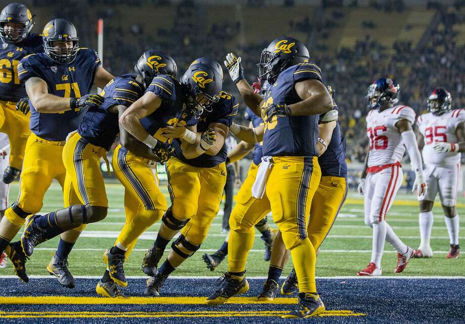 California Golden Bears running back Patrick Laird (center) celebrates his touchdown run during the first quarter of an NCAA football game between the California Golden Bears and the Mississippi Rebels at California Memorial Stadium on Saturday, Sept. 16, 2017, in Berkeley, in Berkeley, Calif. The Rebels lead 16-7 at halftime. Photo: Santiago Mejia, The Chronicle
