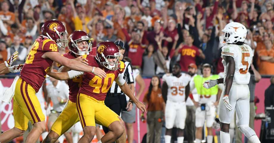 PHOTOS: USC 27, UT 24 (2OT)USC kicker Chase McGrath (40) is mobbed by teammates after kicking the game-winning field goal in overtime against Texas at the Los Angeles Memorial Coliseum on Saturday, Sept. 16, 2017. (Wally Skalij/Los Angeles Times/TNS)Browse through the slideshow to see action from the Longhorns' loss against USC on Saturday night. Photo: Wally Skalij/TNS