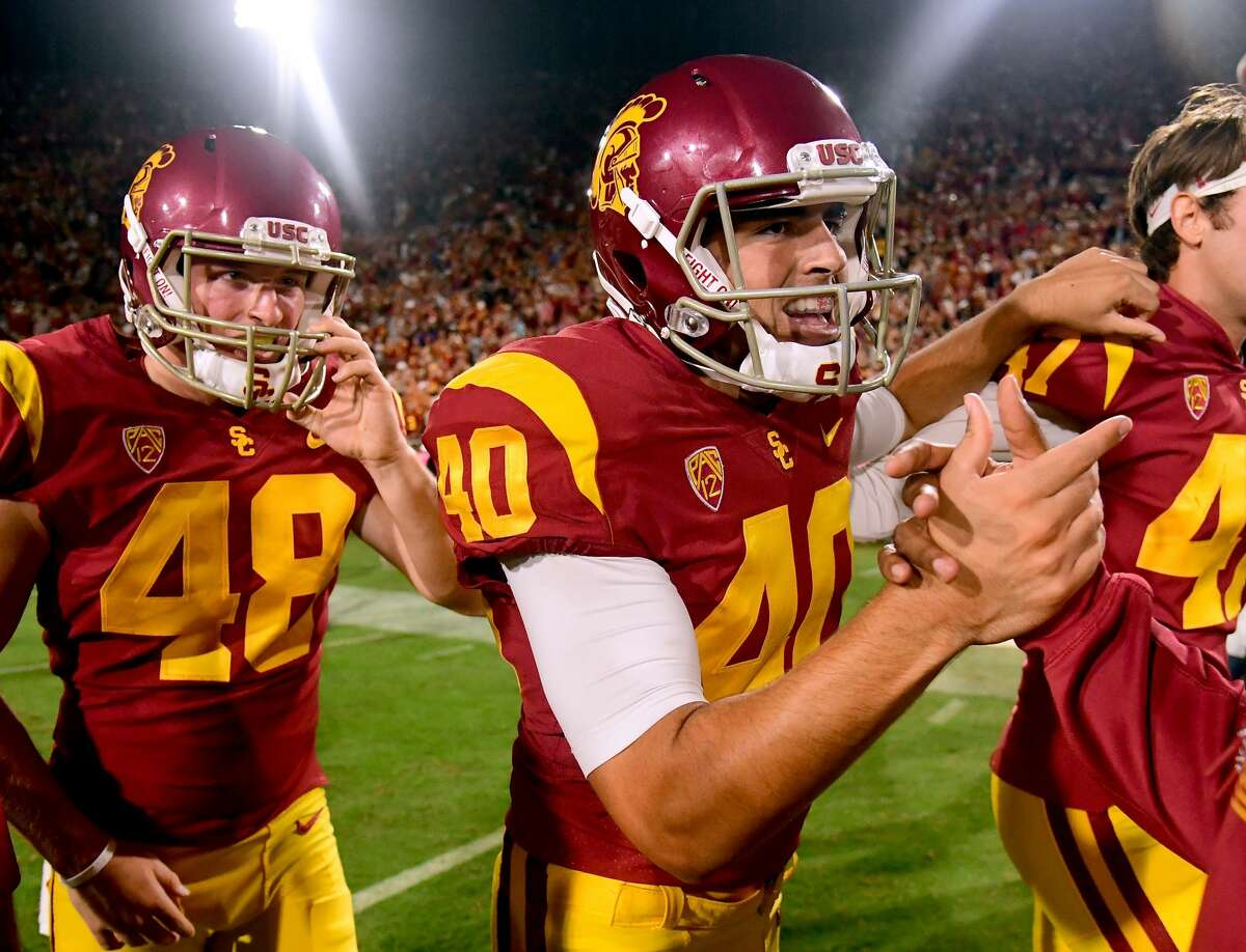 LOS ANGELES, CA - SEPTEMBER 16: Chase McGrath #40 of the USC Trojans celebrates his game winning field goal to beat the Texas Longhorns 27-24 in overtime at Los Angeles Memorial Coliseum on September 16, 2017 in Los Angeles, California. (Photo by Harry How/Getty Images)