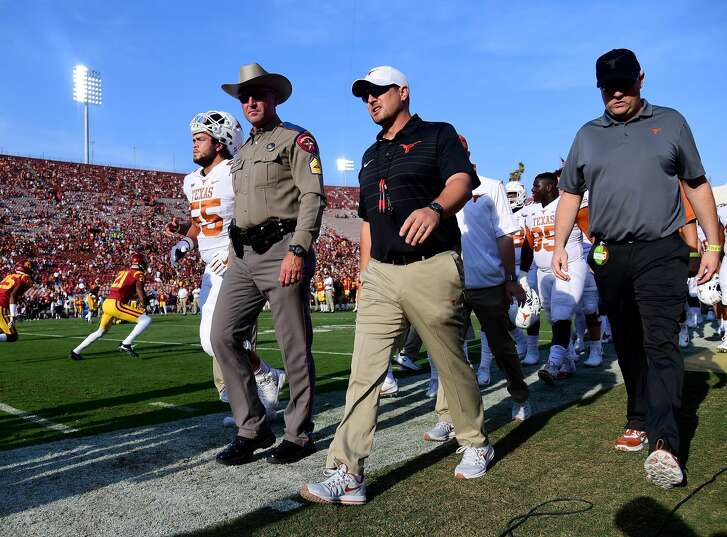 LOS ANGELES, CA - SEPTEMBER 16:  Head coach Tom Herman of the Texas Longhorns walks off the field before the start of the game against the USC Trojans at Los Angeles Memorial Coliseum on September 16, 2017 in Los Angeles, California.  (Photo by Harry How/Getty Images)