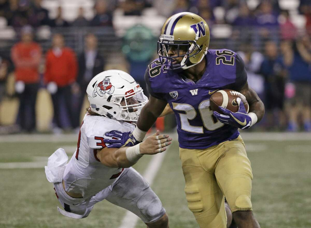 Running Backs The loss of Myles Gaskin is a tremendous blow to UW's running game. Replacing a stud back who never rushed for under 1,200 yards in a season is no easy task, but the Huskies might not be totally out of luck. In all likelihood, junior Salvon Ahmed will take over starting duties. As a sophomore, Ahmed rushed for 608 yards and seven scores. More importantly, he averaged an impressive 5.8 yards per carry. The Kirkland native doesn't quite have the vision of Gaskin, but he brings significantly more top-end speed and explosive potential. Backing him up will probably be juniors Sean McGrew and Kamari Pleasant. Neither saw more than 50 carries last year, but both flashed potential. McGrew, at 5 feet seven inches and 184 pounds, profiles more as a pass-catching threat and third-down back. Pleasant, on the other hand, should be a goal line bruiser at 6 foot, 215 pounds. The group looks solid on paper, but the question will be whether or not Ahmed can succeed in a full-time roll.  Grade: B+