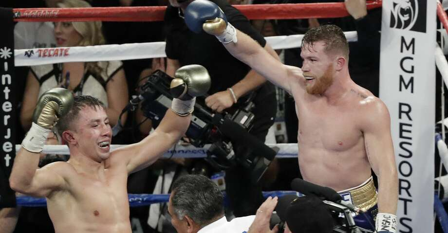 Canelo Alvarez, right, and Gennady Golovkin celebrate following a middleweight title fight Sunday, Sept. 17, 2017, in Las Vegas. The fight was called a draw. (AP Photo/Isaac Brekken) Photo: Isaac Brekken/Associated Press