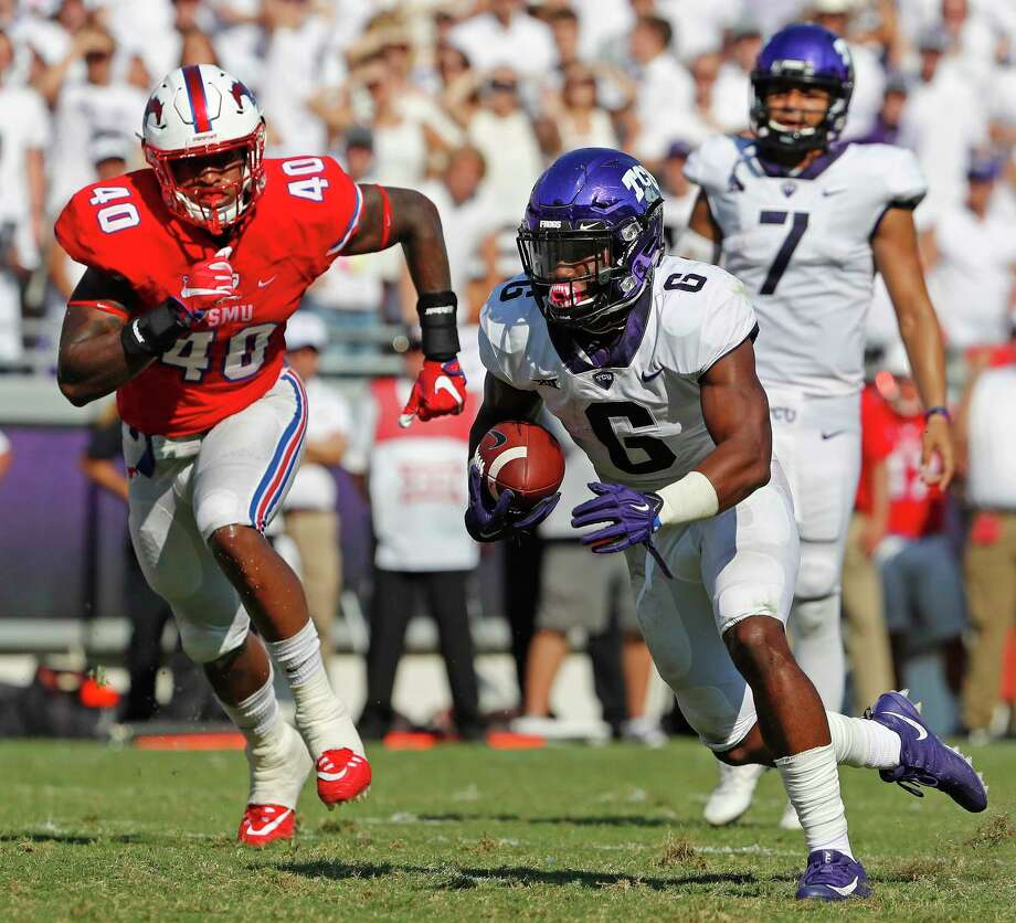 TCU's Darius Anderson, right, scores on a 4-yard run in the third quarter against SMU at Amon Carter Stadium in Fort Worth. Photo: Paul Moseley, MBR / Fort Worth Star-Telegram