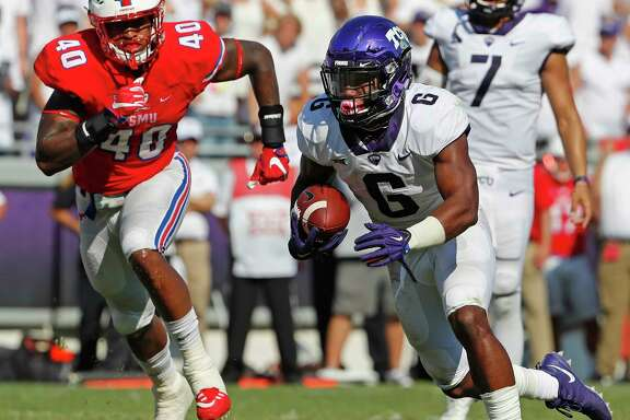 TCU's Darius Anderson, right, scores on a 4-yard run in the third quarter against SMU at Amon Carter Stadium in Fort Worth.