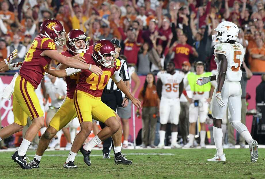 USC freshman kicker Chase McGrath, center, missed a field-goal try early, but he nailed field goals at the end of regulation and in the second OT to secure the victory. Photo: Wally Skalij, MBR / Los Angeles Times