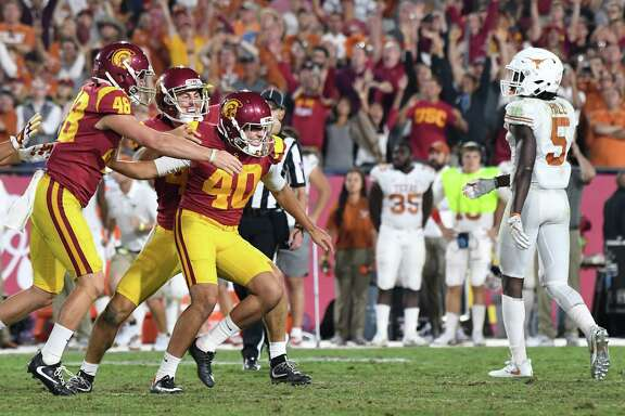 USC freshman kicker Chase McGrath, center, missed a field-goal try early, but he nailed field goals at the end of regulation and in the second OT to secure the victory.