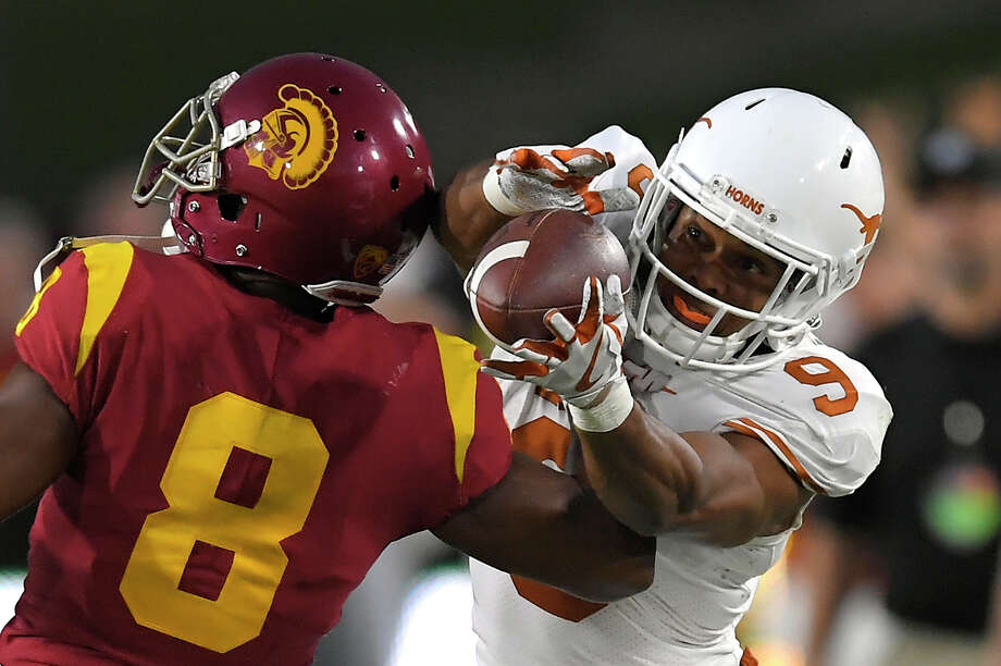 UT receiver Collin Johnson,right, was a lifeline for QB Sam Ehlinger with seven catches for 191 yards. Photo: Mark J. Terrill, STF / Copyright 2017 The Associated Press. All rights reserved.