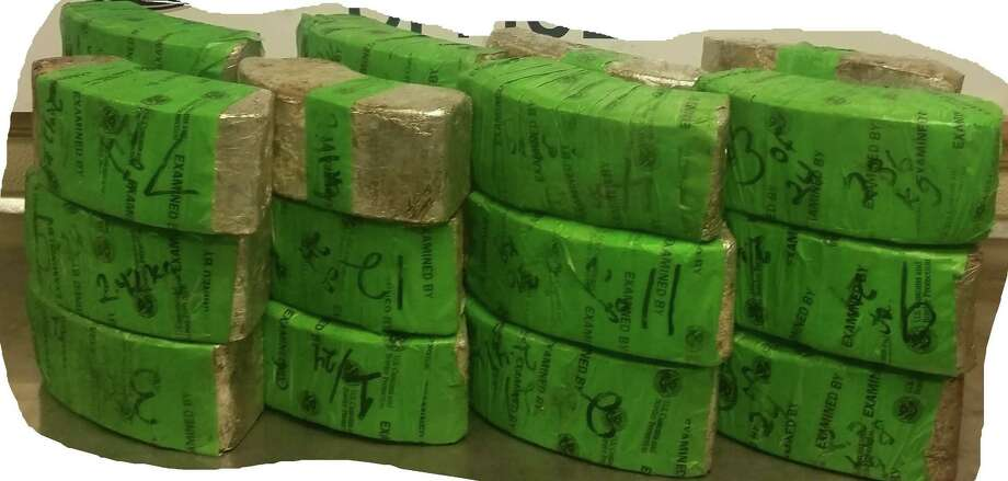 CBP officers discovered a total of 24 packages hidden within a vehicle allegedly containing 127 pounds of crystal methamphetamine and 226 pounds of liquid methamphetamine. Photo: Courtesy