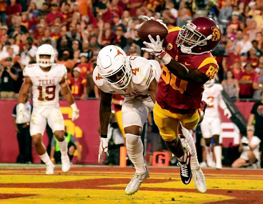LOS ANGELES, CA - SEPTEMBER 16:  Deontay Burnett #80 of the USC Trojans makes a catch for a touchdown in front of DeShon Elliott #4 of the Texas Longhorns to take a 7-0 lead during the second quarter at Los Angeles Memorial Coliseum on September 16, 2017 in Los Angeles, California.  (Photo by Harry How/Getty Images) Photo: Harry How/Getty Images