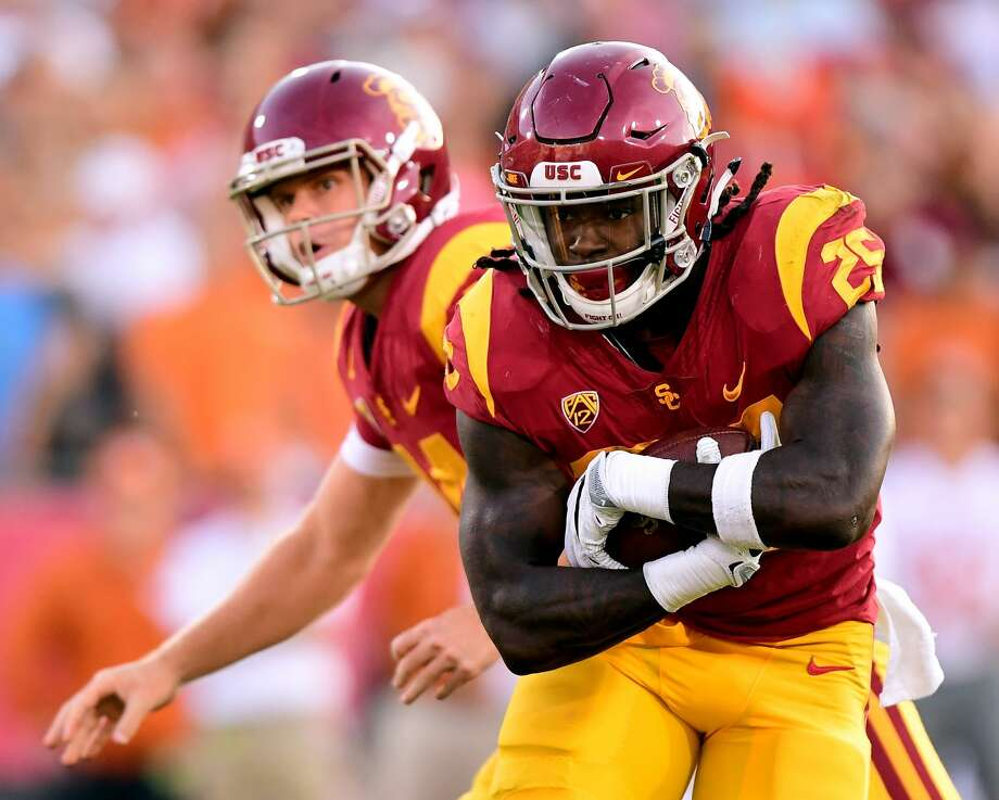 LOS ANGELES, CA - SEPTEMBER 16:  Ronald Jones II #25 of the USC Trojans takes a handoff from Sam Darnold #14 during the first quarter against the Texas Longhorns at Los Angeles Memorial Coliseum on September 16, 2017 in Los Angeles, California.  (Photo by Harry How/Getty Images) Photo: Harry How/Getty Images