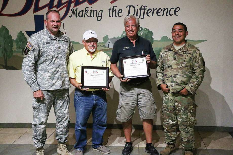 Awards were given to Liberty Airport Manager Phil Robertson and Mike Rawls, a tenant at the airport. At left is Maj. Michael Ford and far right is Sgt. 1st Class Orlando Ramirez of the Texas National Guard 636 BSB. Photo: David Taylor