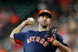 Houston Astros starting pitcher Justin Verlander (35) pitches during the first inning of an MLB baseball game at Minute Maid Park, Sunday, Sept. 17, 2017, in Houston.