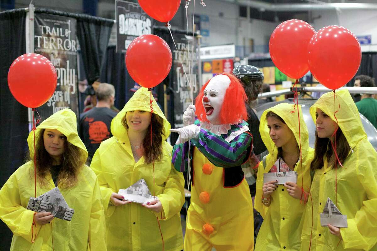 IT, left to right: Madison Correa age 15 from Fairfield, CT, Eden Jezierski from Norwalk, CT, @kraftykacen as Pennywise from CT, Millie Alvarez Guerrero age 16 from Fairfield, CT, and Madison Lagana age 16 from Greenwich, CT. The CT HorrorFest took place on Saturday, September 16th, at The Danbury Arena in Danbury, CT.