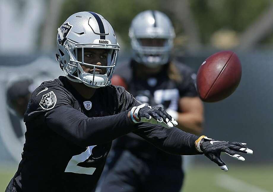 Oakland Raiders cornerback Gareon Conley tosses a ball during football practice on June 13, 2017. Photo: Ben Margot, Associated Press