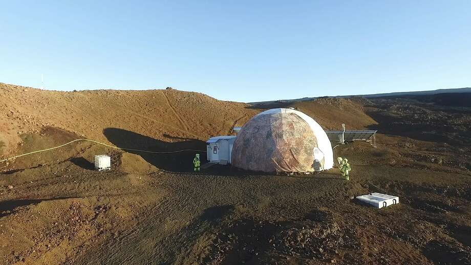 Crew members walk around the Hawaii Space Exploration Analog and Simulation center near the Big Island's Mauna Loa volcano. They emerged Sunday after eight months in isolation. Photo: University Of Hawaii, Associated Press
