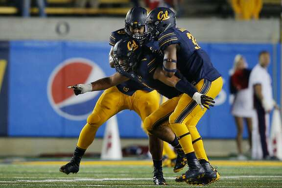 California Golden Bears linebacker Devante Downs (1) and his teammates celebrate after Downs sacked the quarterback on fourth down giving the Bears the winning possession during the fourth quarter of an NCAA football game between the California Golden Bears and the Mississippi Rebels at California Memorial Stadium on Saturday, Sept. 16, 2017, in Berkeley, in Berkeley, Calif. The Golden Bears won 27-16.