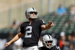 Oakland Raiders' Giorgio Tavecchio and Marquette King warm up before playing New York Jets during NFL game at Oakland Coliseum in Oakland, Calif., on Sunday, September 17, 2017.