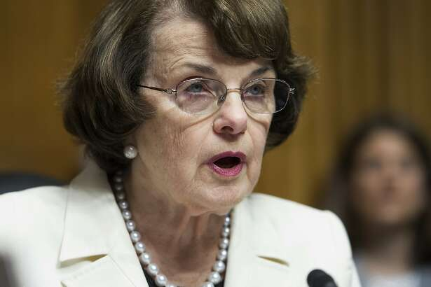 """FILE - In this May 10, 2017, file photo, Sen. Dianne Feinstein, D-Calif., speaks on Capitol Hill in Washington. Catholic leaders and university presidents are objecting to Feinstein's line of questioning for one of President Donald Trump's judicial nominees, arguing the focus on her faith is misplaced and runs counter to the Constitution's prohibition on religious tests for political office. The outcry stems from the questioning of Amy Coney Barrett, a Notre Dame law professor tapped to serve on the U.S. Court of Appeals for the Seventh Circuit. Democrats focused on whether her personal views would override her legal judgment, especially with respect to the landmark 1973 Supreme Court decision legalizing abortion. Feinstein told Barrett that dogma and law are two different things and she was concerned """"that the dogma lives loudly within you."""" (AP Photo/Cliff Owen, File)"""