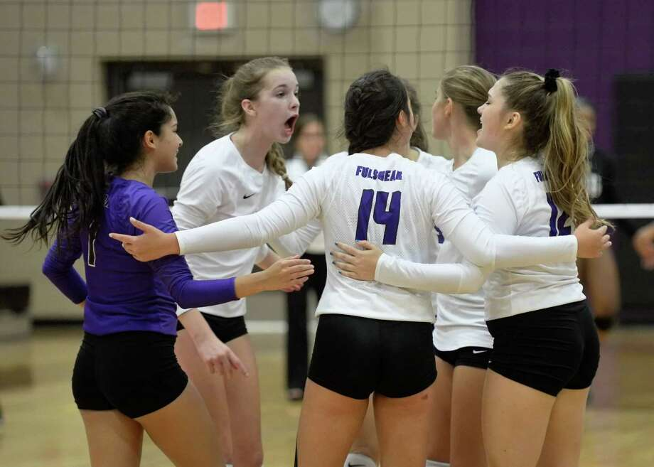The Fulshear team celebrates a point in the first set of a high school volleyball game between the Fulshear Chargers and the Foster Falcons on September 12, 2017 at Fulshear High School, Fulshear, TX. Photo: Craig Moseley, Staff / ©2017 Houston Chronicle
