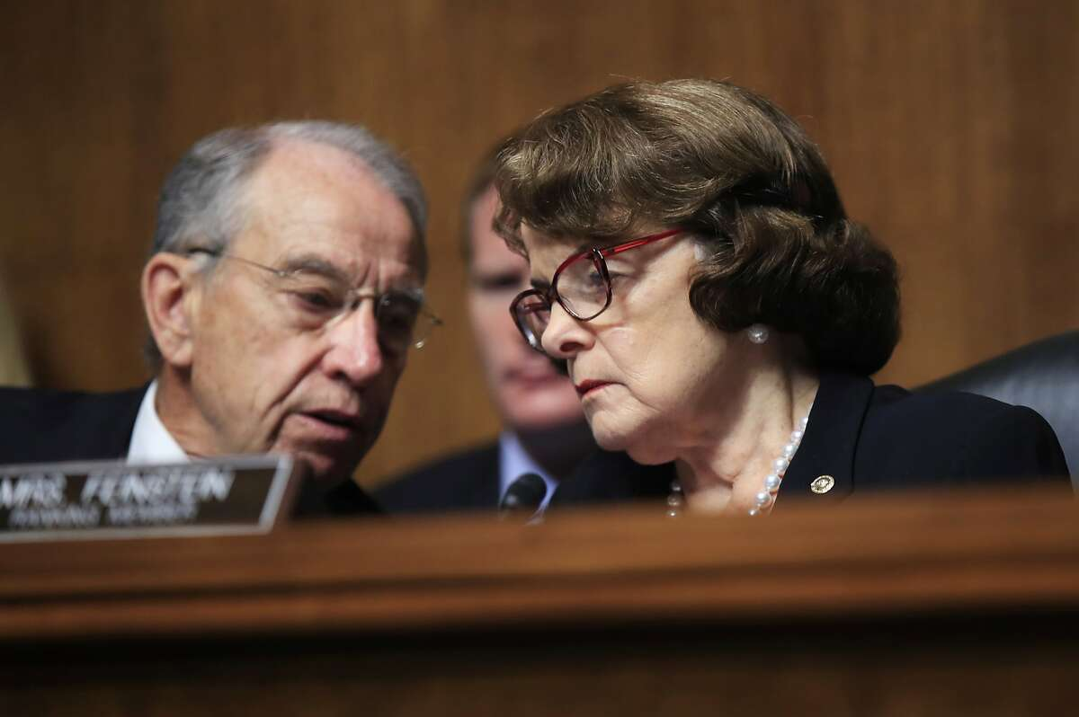 Senate Judiciary Committee Chairman Sen. Charles Grassley of Iowa, confers with ranking member, Sen. Dianne Feinstein of California during a hearing on Capitol Hill in Washington, Wednesday, Sept. 6, 2017, regarding Eric Dreiband's nomination to be Assistant Attorney General, Civil Rights Division.