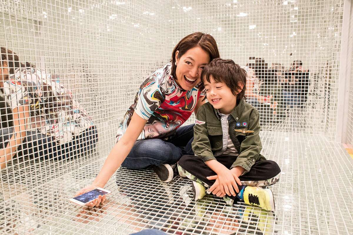 Aey Phanachet (left) and Jake Evans sit in a room of mirrors that visitors to the Museum of Ice Cream are able to crawl into for photos in San Francisco, Calif., on Sunday, September 17, 2017. The pop-up exhibit opened to the public on Sunday.
