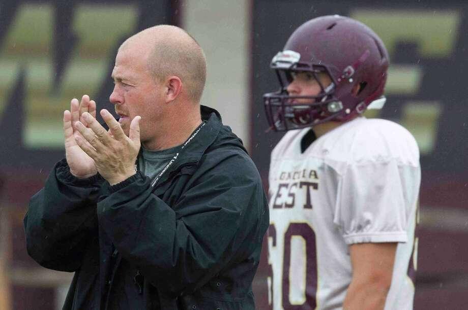 Magnolia West football coach J.D. Berna encourages his team during a practice. Photo: Jason Fochtman / Conroe Courier / HCN