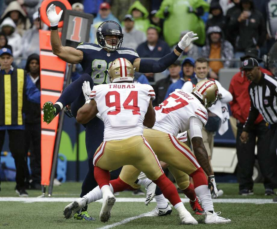 Seattle Seahawks tight end Jimmy Graham, upper left, leaps during a play against the San Francisco 49ers during the first half of an NFL football game, Sunday, Sept. 17, 2017, in Seattle. Graham went down with an injury after the play. (AP Photo/Elaine Thompson) Photo: Elaine Thompson/AP
