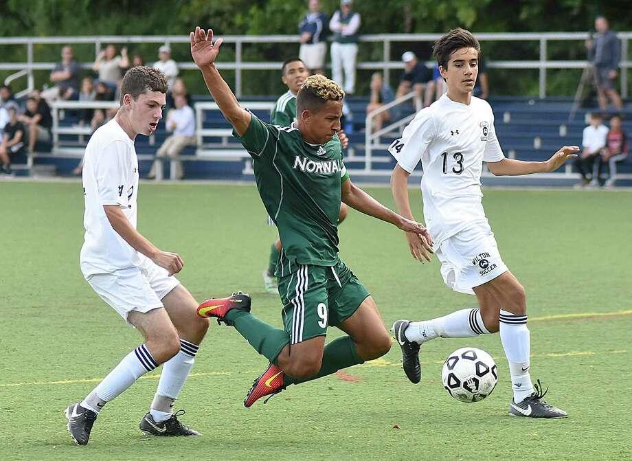 Norwalk's Sebastian Echeverri, center, has five of his team's six goals. Photo: John Nash / Hearst Connecticut Media / Norwalk Hour
