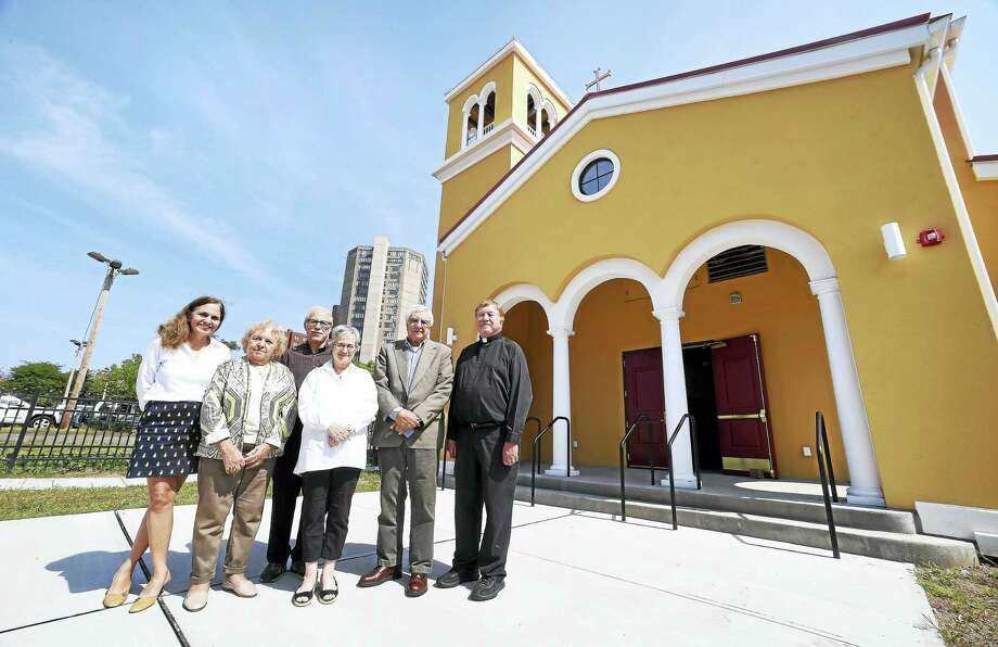 Left to right, parishioners Penelope Tambis, her mother, Nanne Tambis, Arven Saunders, Athena Condos, her husband, Spyros Condos and the Rev. Donat Augusta are photographed in front of St. Basil's Greek Orthodox Church's new building in New Haven. Photo: Arnold Gold / Hearst Connecticut Media / New Haven Register