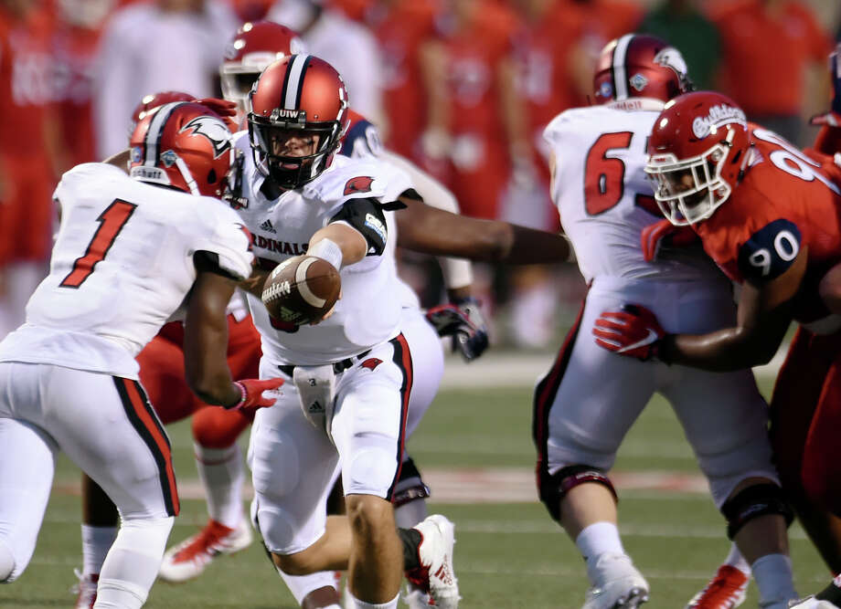 FILE PHOTO: Incarnate Word quarterback Sean Brophy, center, hands off to running back Desmond Hite, left, during an NCAA college football game against Fresno State on Saturday, Sept. 2, 2017, in Fresno, Calif. (Eric Paul Zamora/The Fresno Bee via AP) Photo: ERIC PAUL ZAMORA, Associated Press / The Fresno Bee