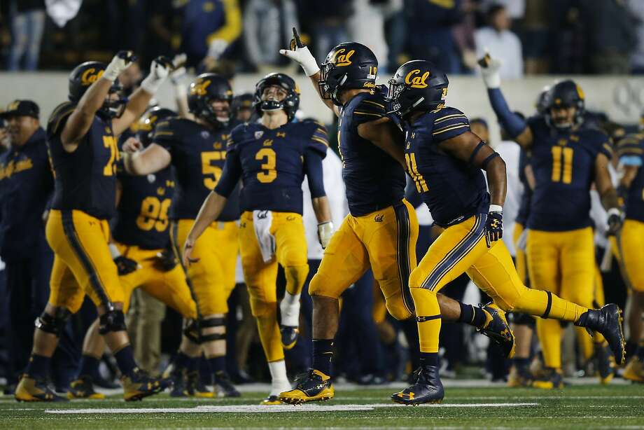 Cal linebacker Devante Downs (1) and  teammates celebrate  his sack of Mississippi's quarterback on  Sept. 16 in Berkeley. Photo: Santiago Mejia, The Chronicle