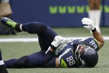 Seattle Seahawks tight end Jimmy Graham lies on the turf with an injury during the first half of an NFL football game against the San Francisco 49ers, Sunday, Sept. 17, 2017, in Seattle. (AP Photo/Elaine Thompson)