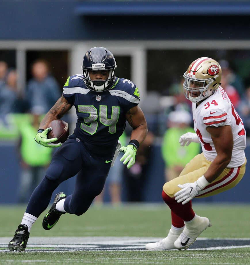 Seattle Seahawks running back Thomas Rawls (34) rushes against San Francisco 49ers defensive end Solomon Thomas (94) in the first half of an NFL football game, Sunday, Sept. 17, 2017, in Seattle. (AP Photo/John Froschauer) Photo: John Froschauer/AP