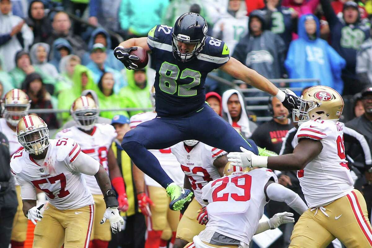 Seahawks tight end Luke Willson hurdles over the 49ers defense during the second quarter of Seattle's game against San Francisco, Sunday, Sept. 17, 2017.