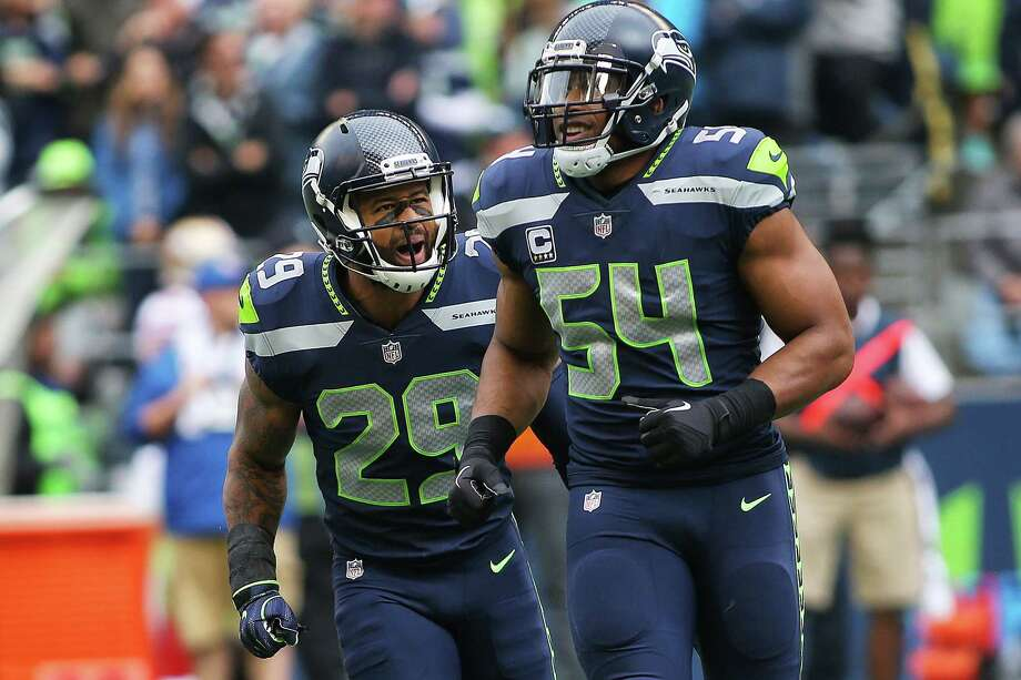 Seahawks safety Earl Thomas and Seahawks linebacker Bobby Wagner celebrate after Wagner intercepted a pass in the first half of Seattle's game against San Francisco, Sunday, Sept. 17, 2017. Photo: GENNA MARTIN, SEATTLEPI / SEATTLEPI.COM