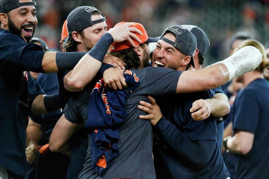 Houston Astros' George Springer, right, and Jake Marisnick celebrate their win over the Seattle Mariners and the clinching of the AL West crown in a baseball game, Sunday, Sept. 17, 2017, in Houston. (AP Photo/Eric Christian Smith) Photo: Eric Christian Smith, FRE / FR171023 AP