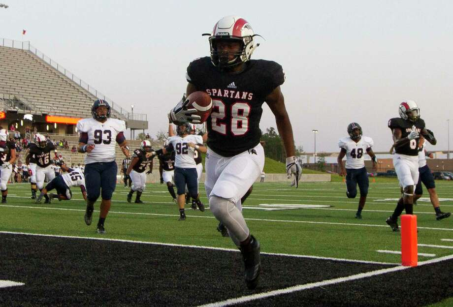 Porter running back Carlos Norman (28) runs for a 13-yard touchdown during the first quarter of a non-district high school game against Katy Tompkins at Texan Drive Stadium, Thursday, Sept. 14, 2017, in New Caney. Photo: Jason Fochtman, Staff Photographer / © 2017 Houston Chronicle