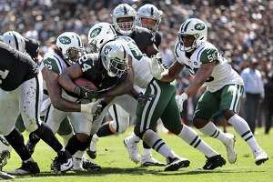 Oakland Raiders' Marshawn Lynch scores a 2nd quarter touchdown against New York Jets during NFL game at Oakland Coliseum in Oakland, Calif., on Sunday, September 17, 2017.