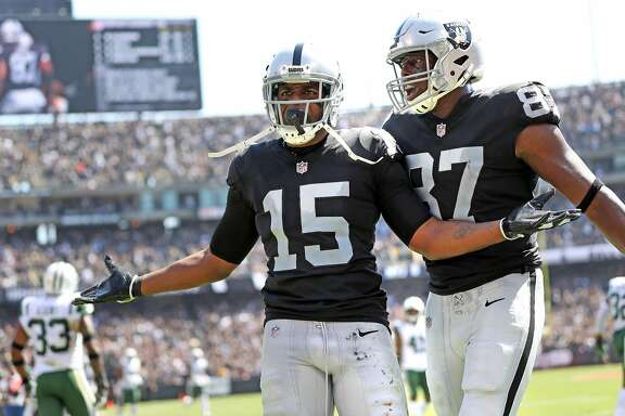 Oakland Raiders' Michael Crabtree celebrates his 2nd quarter touchdown catch with Jared Cook against New York Jets during NFL game at Oakland Coliseum in Oakland, Calif., on Sunday, September 17, 2017.