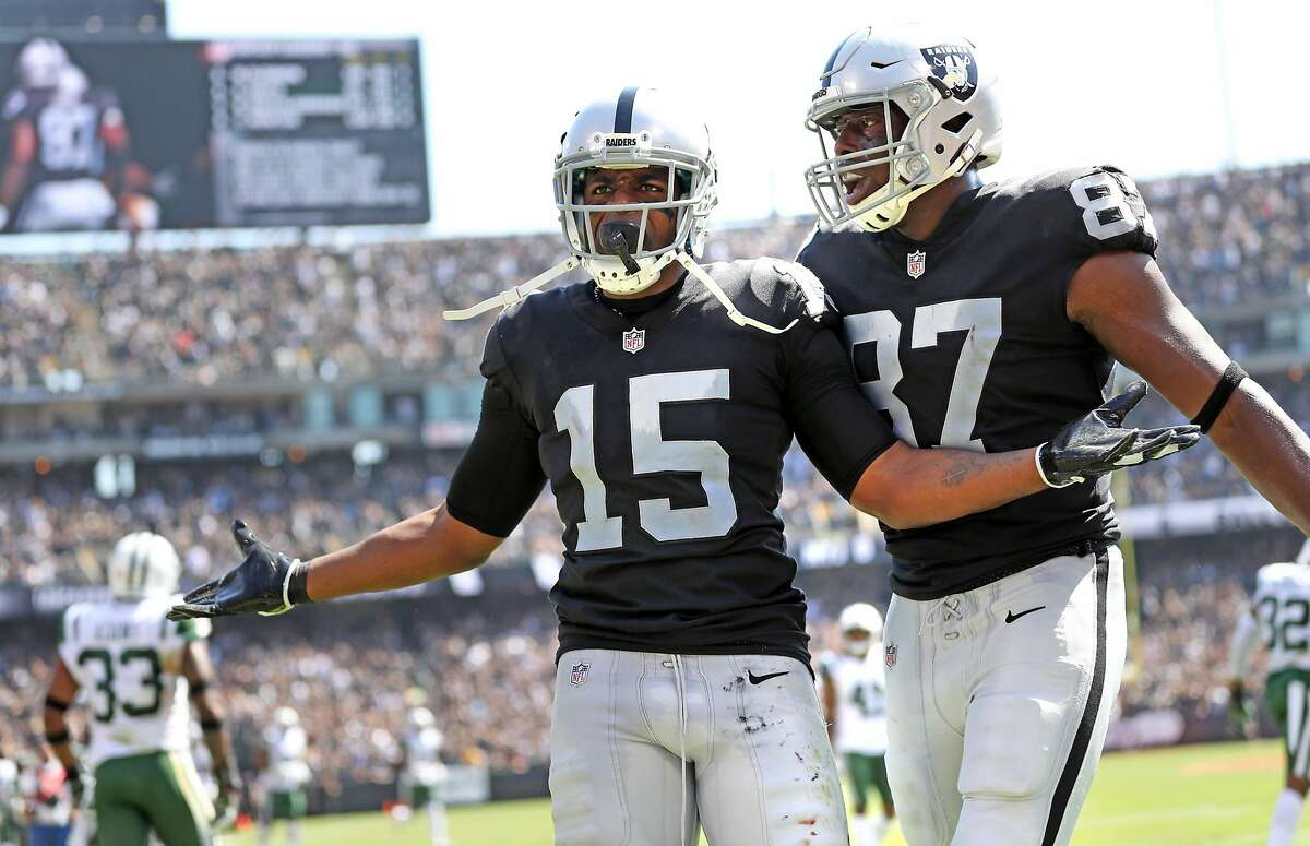 Oakland Raiders' Michael Crabtree celebrates his second-quarter touchdown catch with Jared Cook against the New York Jets during a game at the Oakland Coliseum on Sept. 17. The team may likely stay in Oakland through the 2020 season, a Coliseum official said Monday. The Raiders