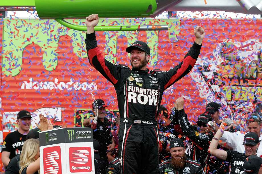 JOLIET, IL - SEPTEMBER 17:  Martin Truex Jr., driver of the #78 Furniture Row/Denver Mattress Toyota, celebrates in victory lane after winning  during the Monster Energy NASCAR Cup Series Tales of the Turtles 400 at Chicagoland Speedway on September 17, 2017 in Joliet, Illinois.  (Photo by Brian Lawdermilk/Getty Images) Photo: Brian Lawdermilk, Stringer / 2017 Getty Images
