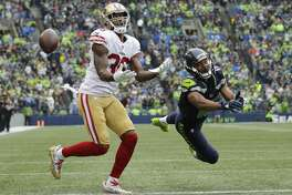 San Francisco 49ers cornerback Dontae Johnson, left, and Seattle Seahawks wide receiver Tyler Lockett, right, watch the ball after Johnson broke up a pass intended for Lockett in the second half of an NFL football game, Sunday, Sept. 17, 2017, in Seattle. (AP Photo/John Froschauer)