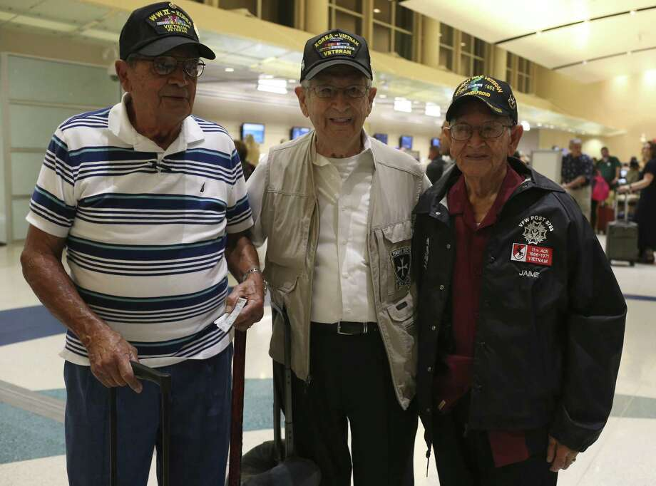 "Korean War veterans from left, Ismael Nevarez, 91, Victor Lopez, 89 and Daniel Jaime, 85, arrive at the San Antonio International Airport for their flight to Korea, Sunday, Sept. 17, 2017. They served in the U.S. Army 65th Infantry Regiment known as ""The Borinqueneers"". The regiment was a segregated unit made up of mostly Puerto Ricans. Nevarez and Lopez are from Puerto Rico but now live in San Antonio and Jaime is from McAllen and was born in Mexican state of Nuevo Leon. Photo: JERRY LARA, Staff / San Antonio Express-News / © 2017 San Antonio Express-News"