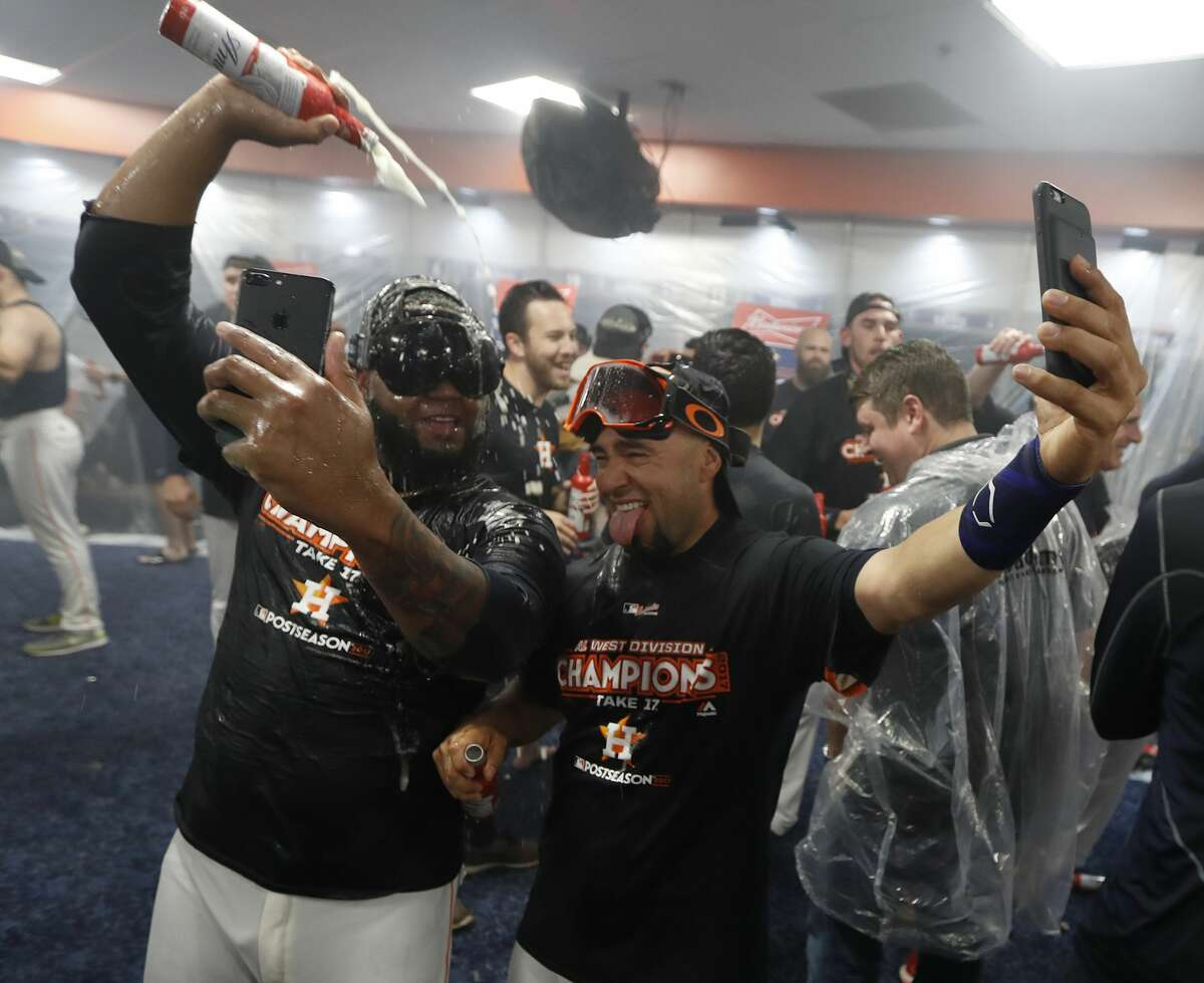 Houston Astros Francis Martes and bullpen catcher Javier Bracamonte douse each other with beer and champagne as they celebrated after they clinched the American League West crown after beating the Seattle Mariners 7-1 during an MLB baseball game at Minute Maid Park, Sunday, Sept. 17, 2017, in Houston. ( Karen Warren / Houston Chronicle )