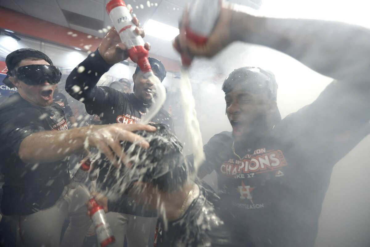 PHOTOS: Astros celebrating with the fog machine in the clubhouse Houston Astros players douse bullpen catcher Carlos Munoz as they celebrated after they clinched the American League West crown after beating the Seattle Mariners 7-1 during an MLB baseball game at Minute Maid Park, Sunday, Sept. 17, 2017, in Houston. ( Karen Warren / Houston Chronicle ) Browse through the photos above for a look at the Astros' division-title celebration earlier this season, which came complete with a fog machine.