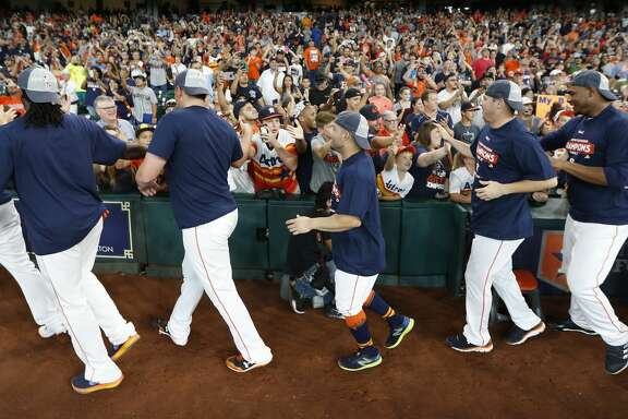 The Houston Astros celebrate with the fans by running around the perimeter of the field after they clinched the American League West crown after beating the Seattle Mariners 7-1 during an MLB baseball game at Minute Maid Park, Sunday, Sept. 17, 2017, in Houston.  ( Karen Warren / Houston Chronicle )