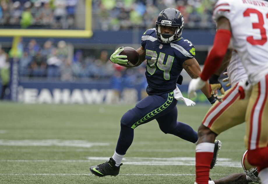 Seahawks running back Thomas Rawls rushes against the San Francisco 49ers, Sunday, Sept. 17, 2017, in Seattle. Photo: Elaine Thompson/AP