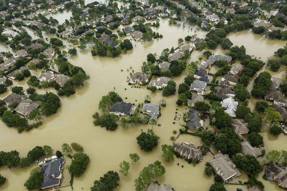 Floodwaters from the Addicks Reservoir inundate a neighborhood off N. Eldridge Parkway in the aftermath of Tropical Storm Harvey on Wednesday, Aug. 30, 2017, in Houston. ( Brett Coomer / Houston Chronicle ) Photo: Brett Coomer, Staff / Houston Chronicle / © 2017 Houston Chronicle