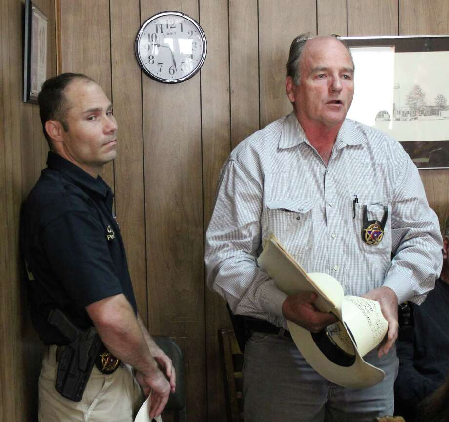 San Jacinto County Pct. 3 Constable Sam Houston (right) discusses the approval of a donation to be used to build a new office space for his department during the Sept. 12 commissioners court meeting. Photo: Jacob McAdams